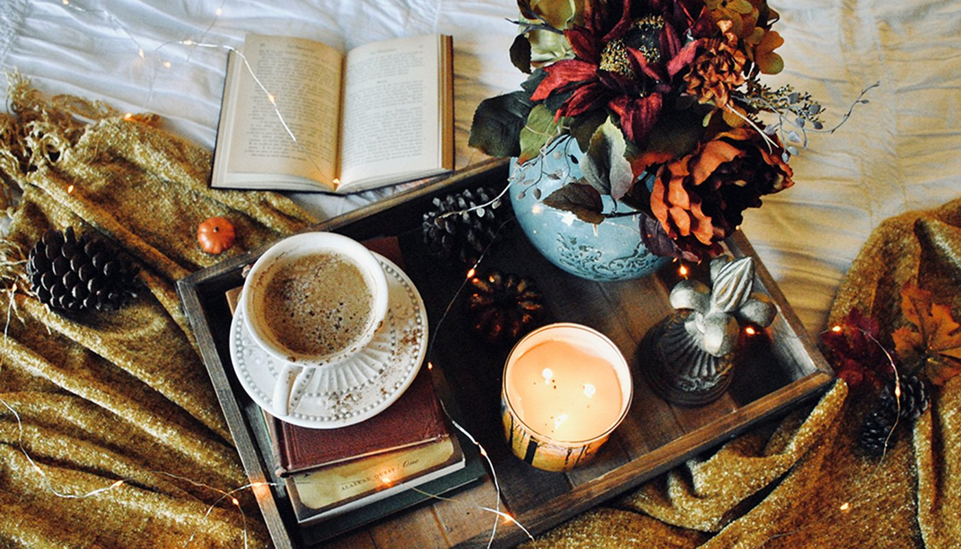 Candle, coffee and book