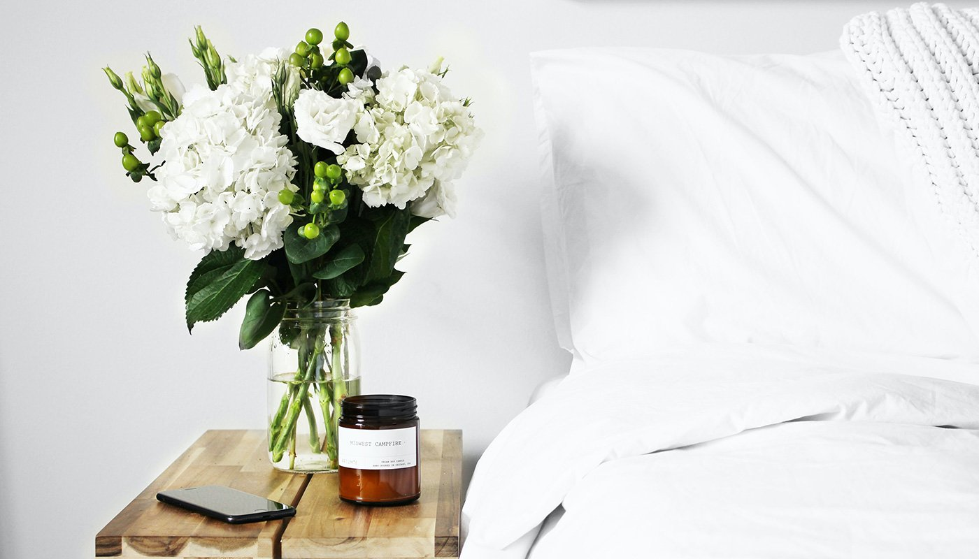 Flower and candle in the bedroom