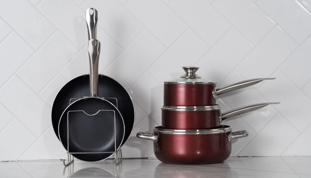 Clean pots and pans in the kitchen