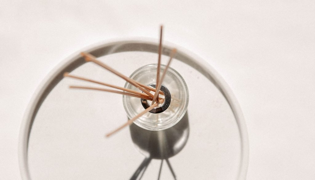 Reed diffuser with sticks on a plate