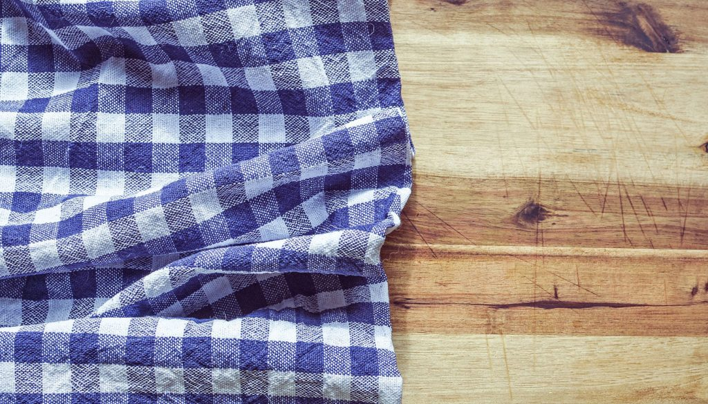 Blue white kitchen towel on cutting board
