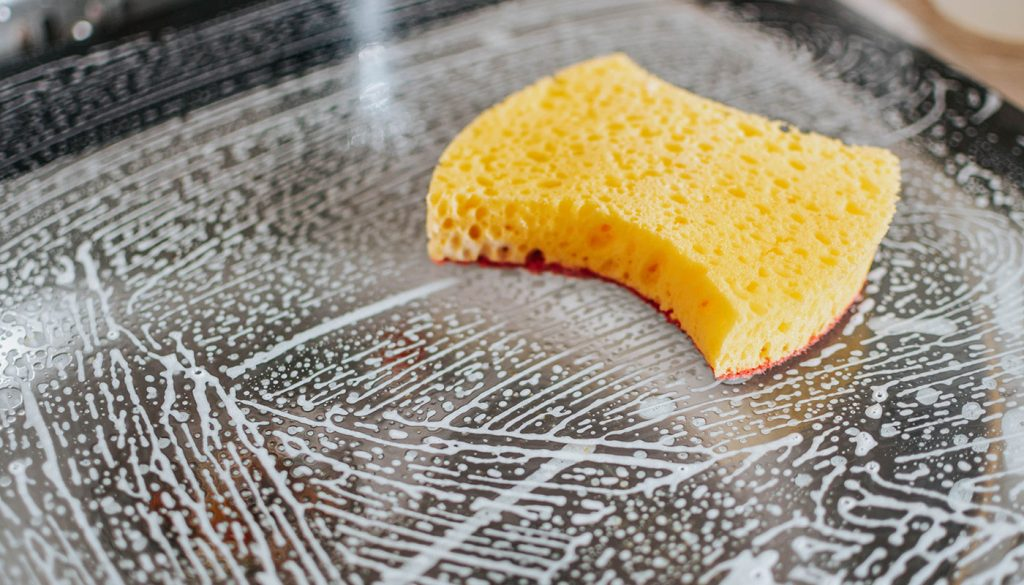 Cleaning with sponge in the kitchen