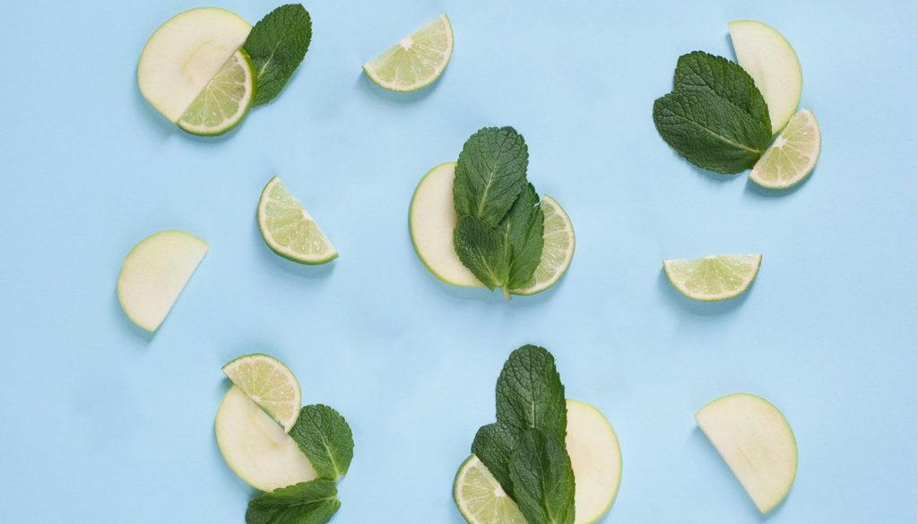 Green apple and lime slices with mint