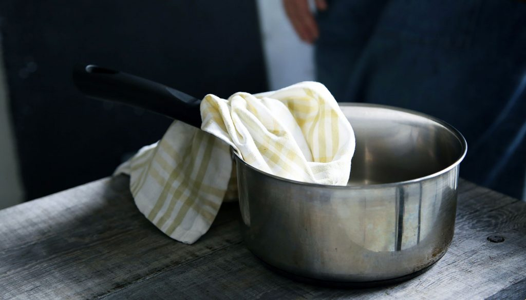 Kitchen towel left in a pot